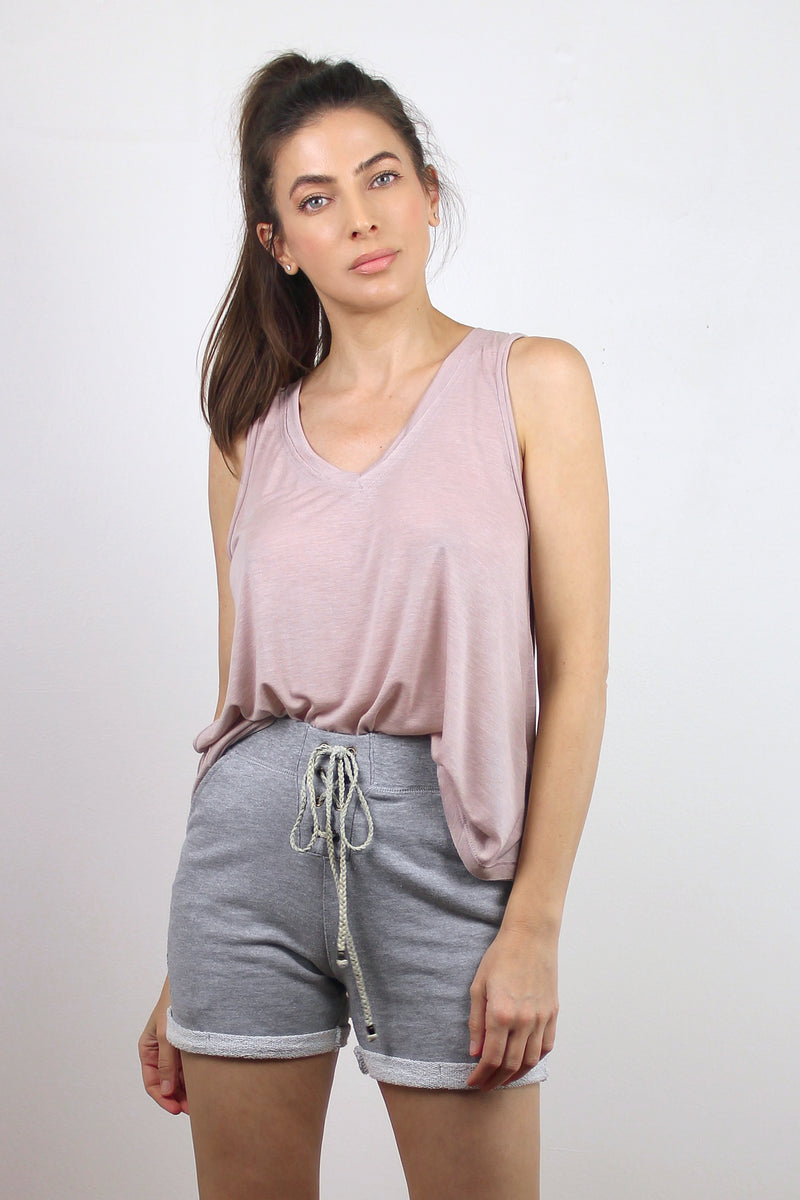 Loose fitting light pink tank top.