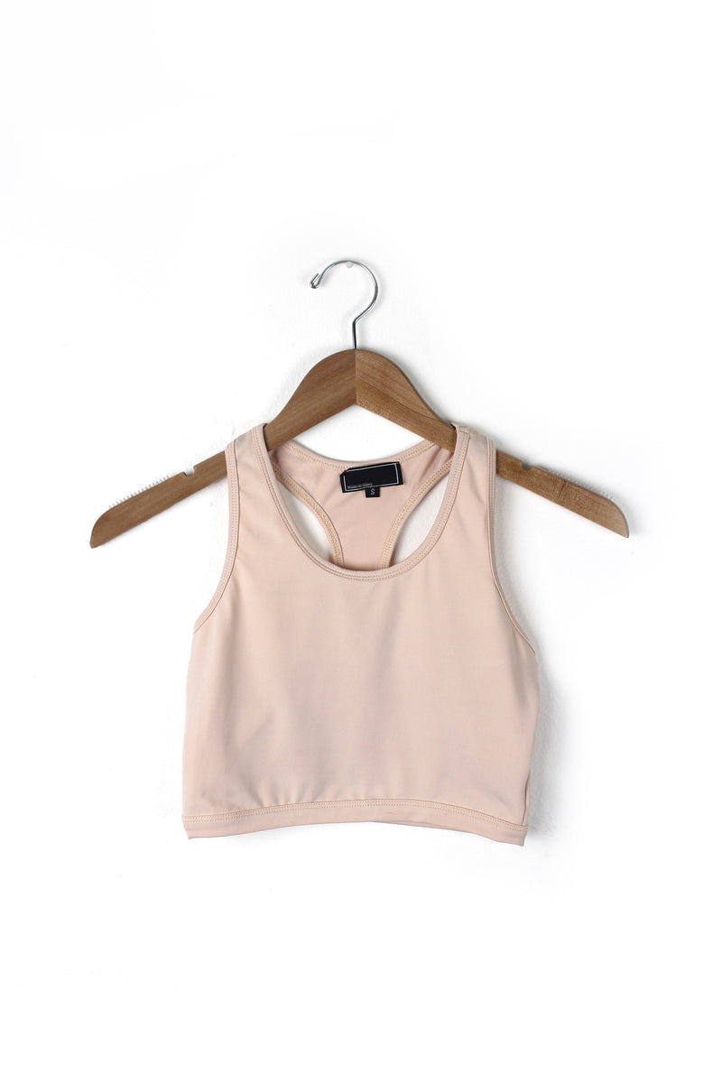 Nude cropped sports bra top.
