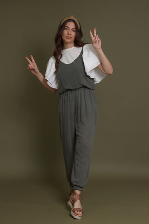 Olive jumpsuit with pockets. Image 2