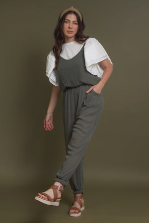 Olive jumpsuit with pockets. Image 4