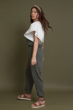Olive jumpsuit with pockets. Image 5