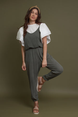 Olive jumpsuit with pockets. Image 6
