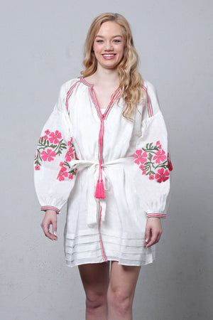 White linen embroidered dress with puff sleeves. Image 2