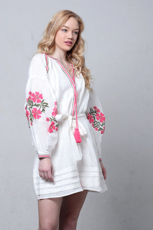 White linen embroidered dress with puff sleeves. Image 3