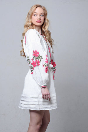 White linen embroidered dress with puff sleeves. Image 4