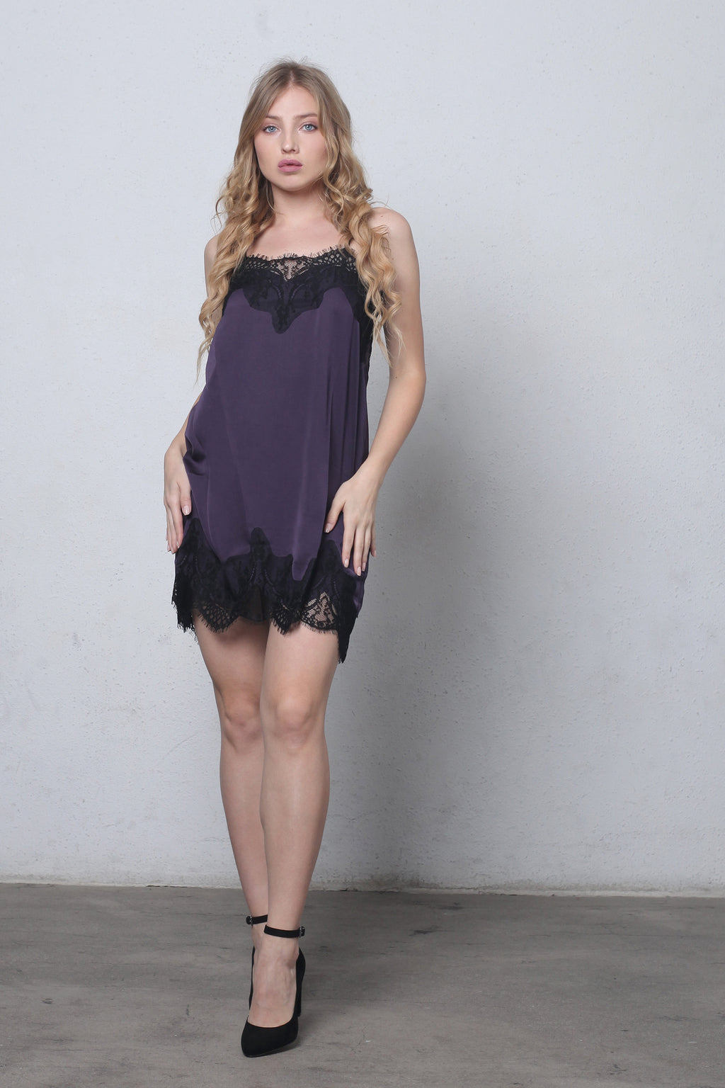 Purple slip dress with lace detail.