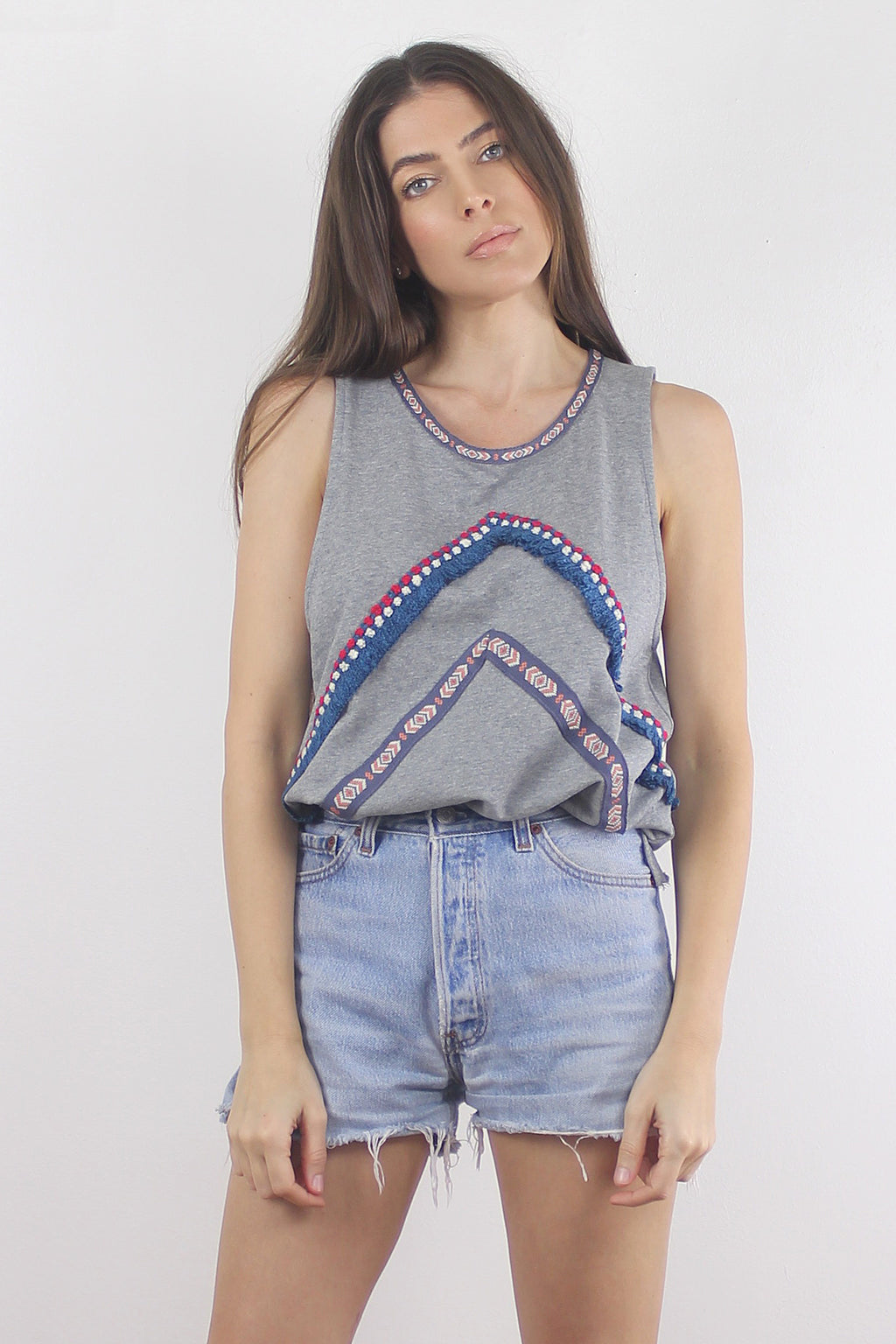 Sleeveless sweatshirt with embroidered and fringe detail.