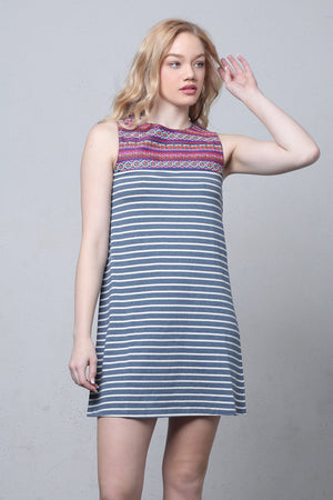 Striped shift dress with embroidered bib.