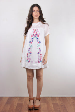 White embroidered mini dress.