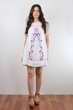 White embroidered mini dress. Image 2