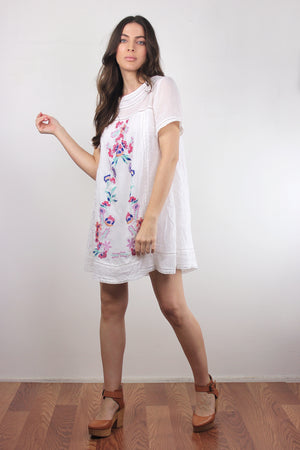 White embroidered mini dress. Image 4