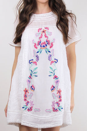 White embroidered mini dress. Image 6