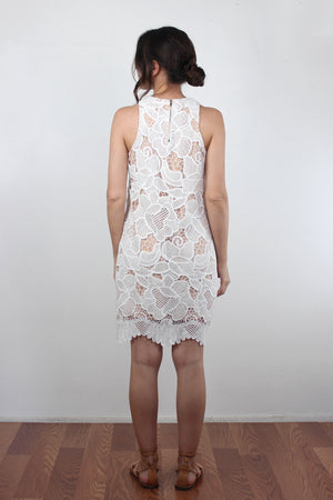 White lace dress with scalloped hem.