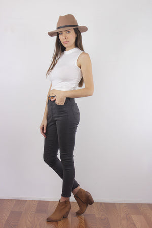 White cropped mock neck tank top with exposed back zipper.