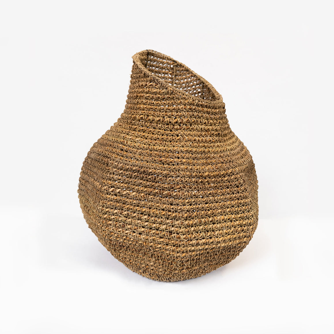 Handmade seagrass boab shaped vessel.