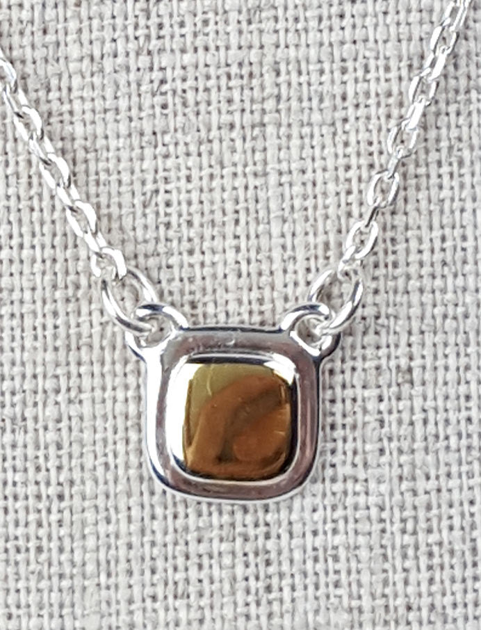 Necklace with square silver medallion with gold plate centre