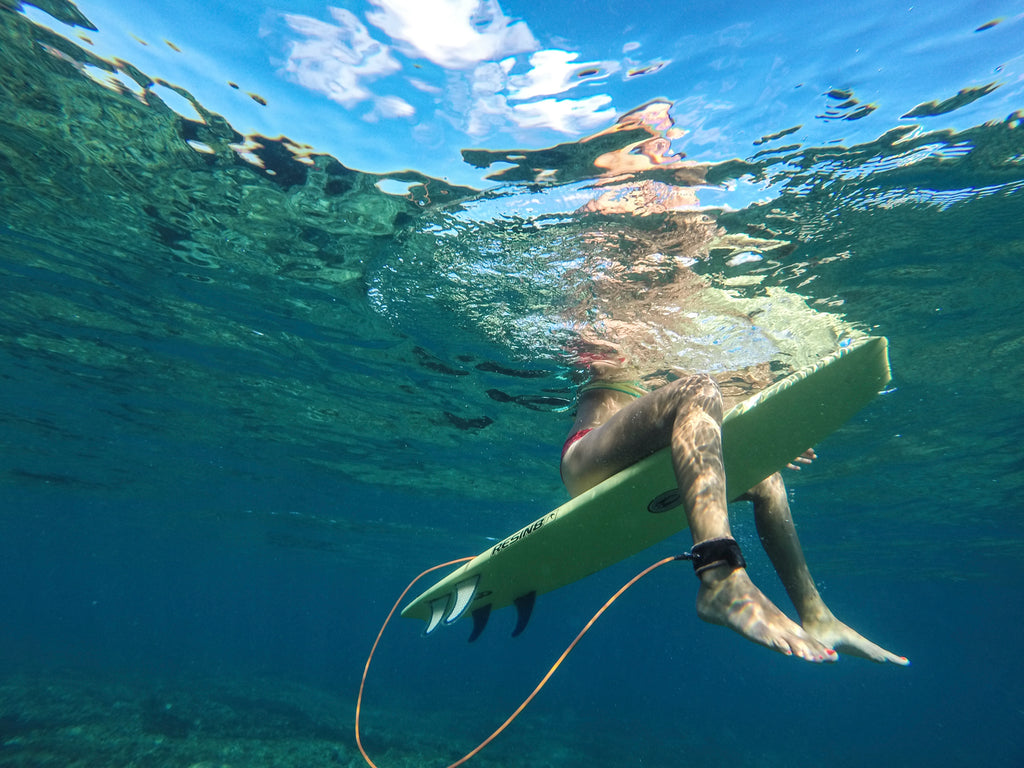 surfer girl underwater