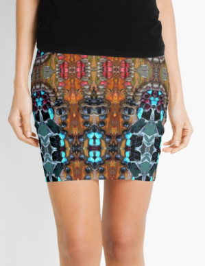 Mini Skirt in Red & Turquoise Graphic Design in Stretch Fabric.