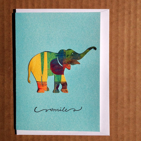 Hand-apinted and handmade greeting card of a smiling elephant.