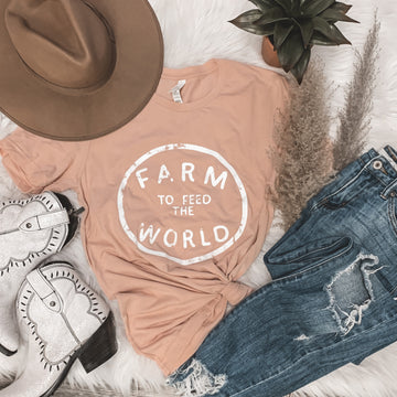 """""""Feed the World"""" Graphic Tee in Peach"""