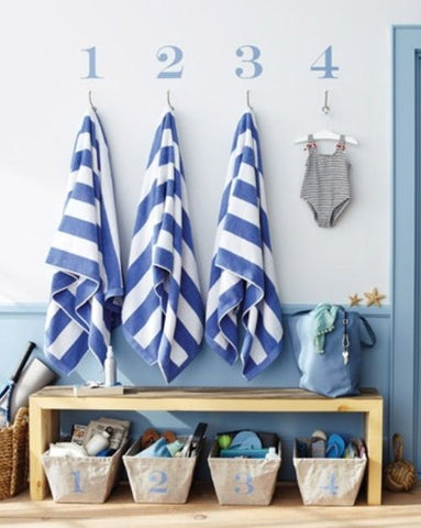 beach house entry numbered towel hooks bench baskets