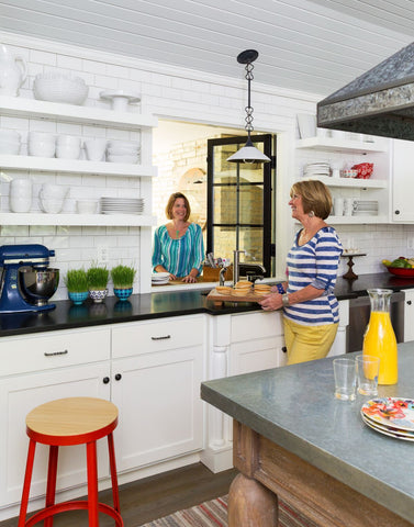 beach house kitchen open shelving pass-thru window kitchen zinc-top island pancakes
