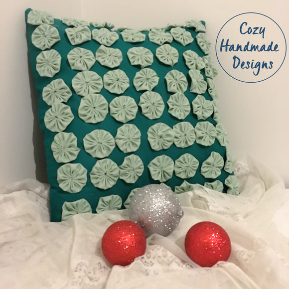 Rosettes Teal Cushion