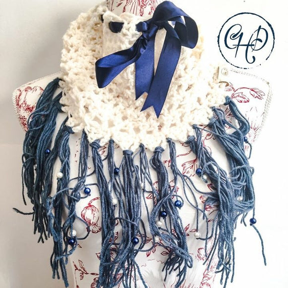 Cream cowl with ribbon, tassels and beads