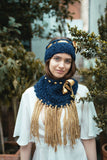 Cowl with decorative ribbon and tassels
