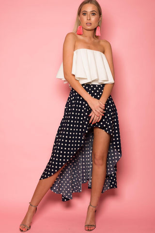 Navy Polka Dot Dipped Hem Skirt