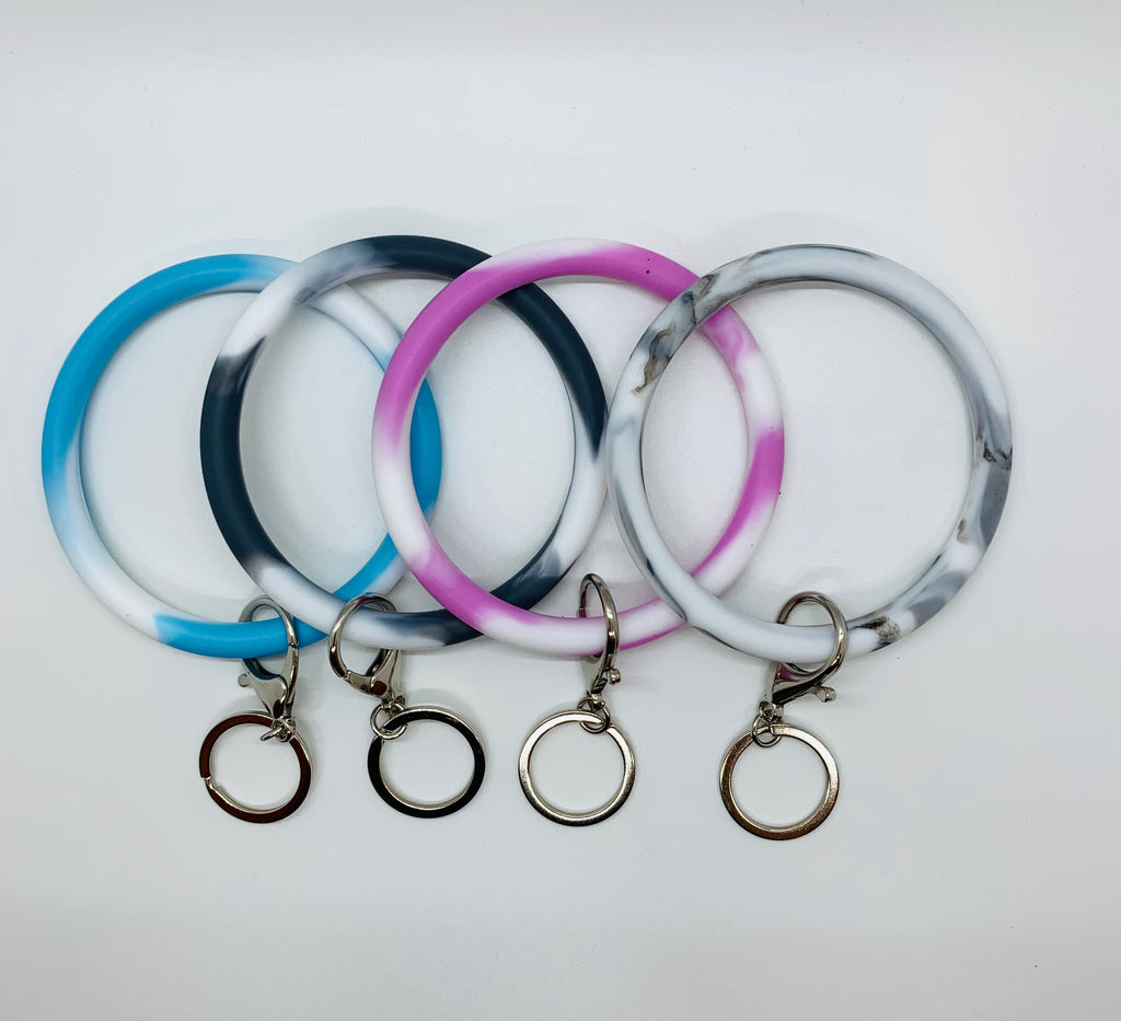 Our Silicone O Rings are the perfect accessory for your Makeup Junkie Bags or as with favorite key chains.  Available in Marble colors: Pink, Blue, Grey and Light Grey.  Comes with attached key ring.