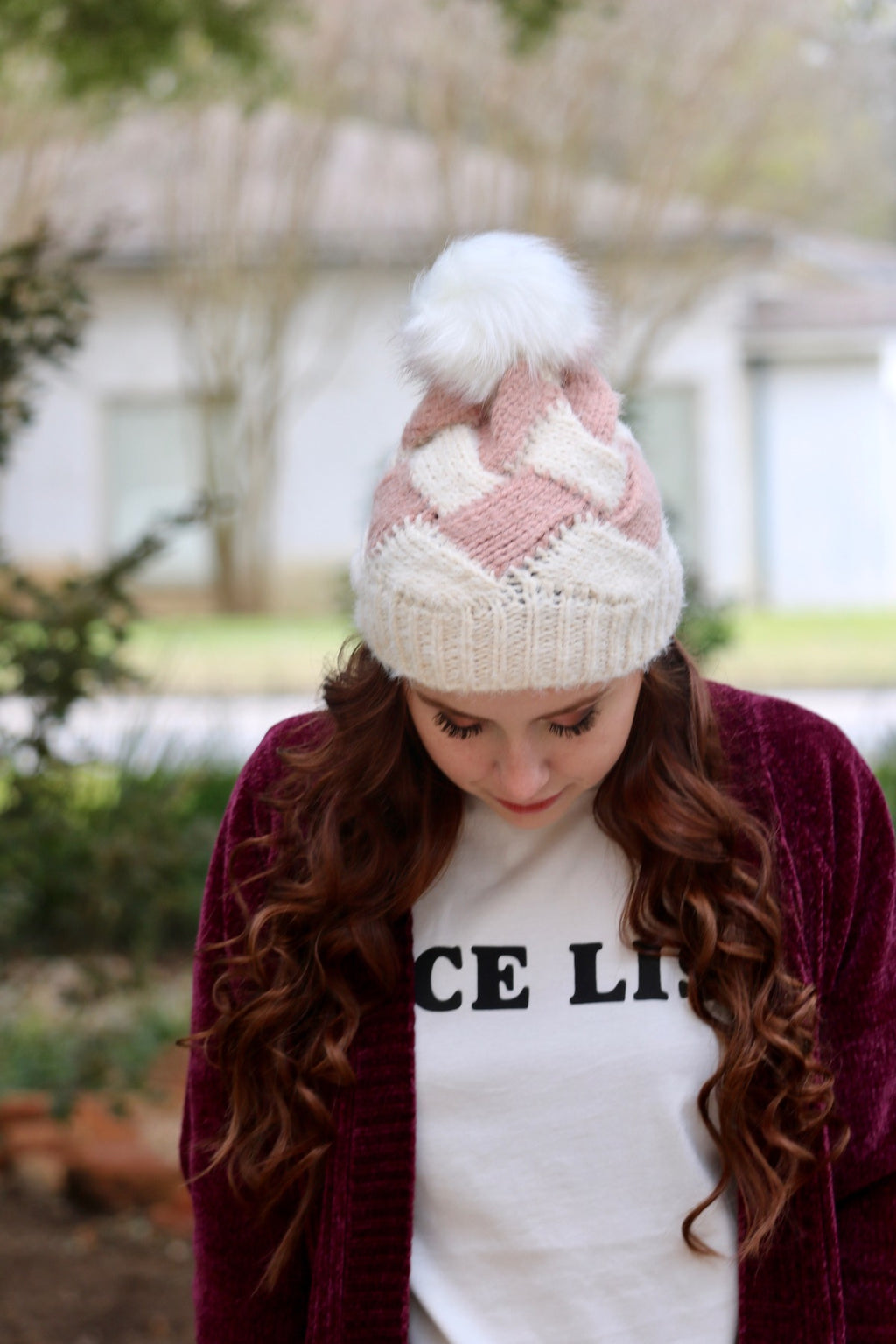 Soft fuzzy knit beanie with faux rabbit fur pom pom.  Rose color beanie with faux pom pom.  100% Acrylic