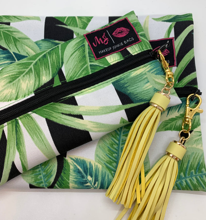 We are so in love with Make Up Junkie Bags!!!  They're perfect for traveling without spilling items all over your bag, and they double as a gorgeous everyday clutch bag.  Plus - they're handcrafted by one of our favorite boutique bosses!!  The Havana Makeup Junkie Bag is a black and white striped bag with palm leaves.