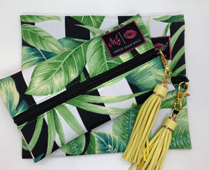 We are so in love with Make Up Junkie Bags!!!  They're perfect for traveling without spilling items all over your bag, and they double as a gorgeous everyday clutch bag.  Plus - they're handcrafted by one of our favorite boutique bosses!!  The Havana Makeup Junkie Bag is a black and white striped bag with palm leaves. This bag features a black wipeable interior.