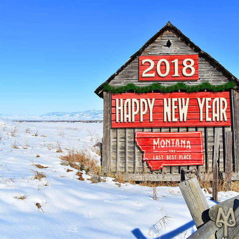 2018 Happy New Year, Montana signs hang on the side of a rustic Bozeman barn