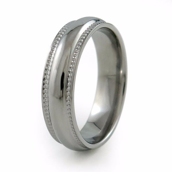 "The Crescent Titanium wedding ring is a classic domed band that has received a beautiful double row of ""milgrain"" (tiny bead shapes). This milgraining brings a certain vintage jewelry transformation to this classically shaped band."