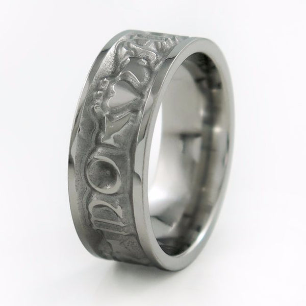 Celtic ring, mens titanium celtic ring. Celtic inscription and Claddagh symbols. The inscription Mo Anam Cara which is Gaelic for My Soul Mate, is carved out with Claddagh symbols between each word.