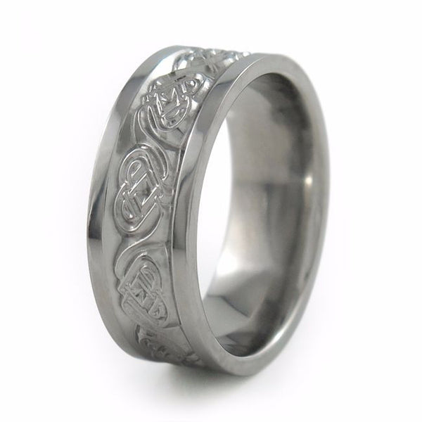titanium ring etched with heart shaped symbols