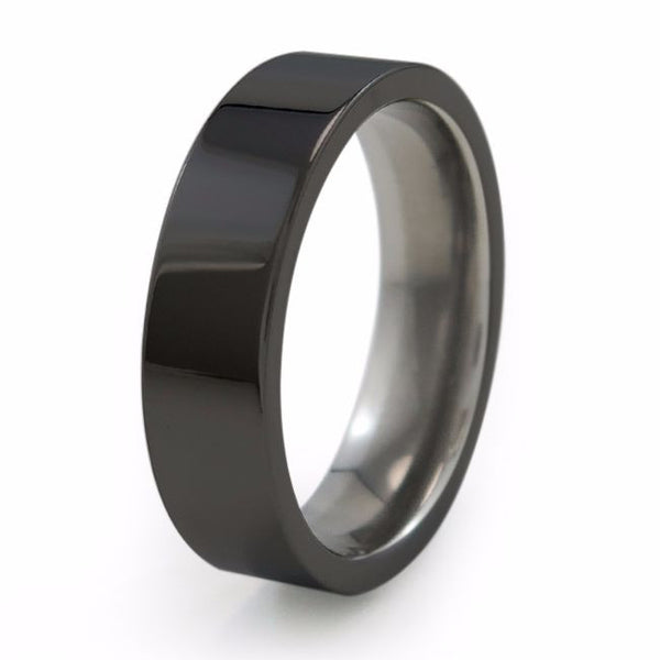 A traditional Titanium wedding ring with black diamond coating. Men's ring and Women's ring
