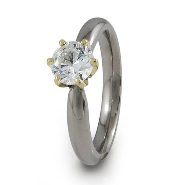 Diamond titanium engagement ring with yellow gold setting