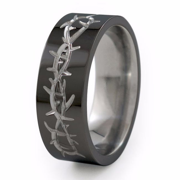 Titanium Ring with a barbed wire design neatly carved into the surface giving the Taboo Titanium ring a cool, rebel-like appeal.