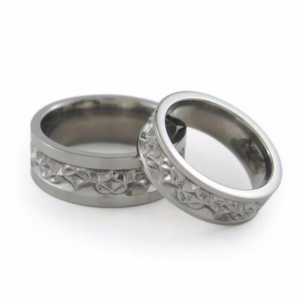 Amore titanium wedding set. Heart shape carvings around the ring.
