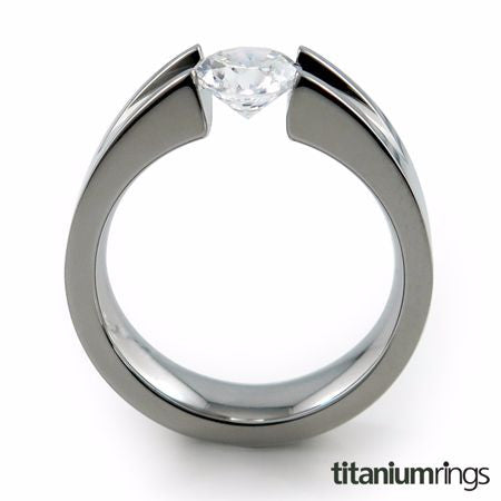Stunning Titanium Engagement Ring with a tension set diamond holds small or big gemstone