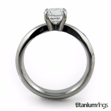 a titanium ring with a slender band and single prong setting that is extremely comfortable to wear. The model shown contains a 6mm round center stone.