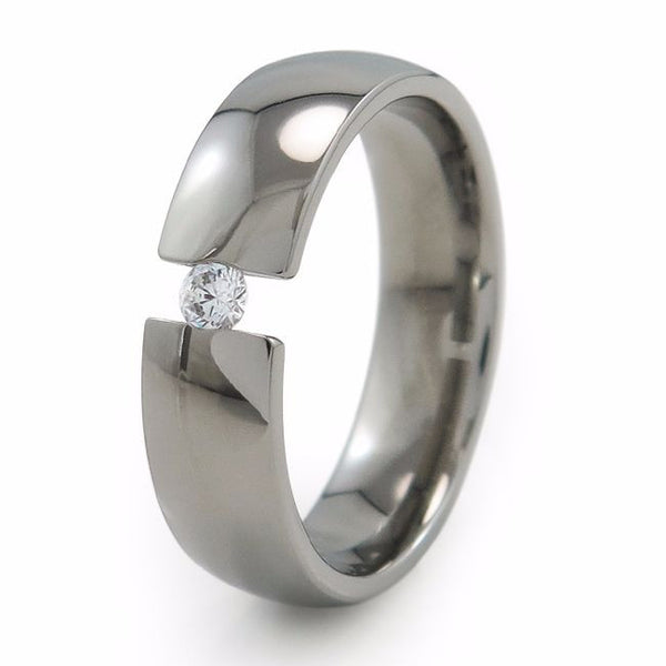 Classic simple elegant titanium ring or wedding band with a single inset gemstone