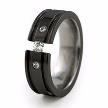 Mens Black Titanium Wedding band called the  Abyss Ring with diamond inset and comfort fit