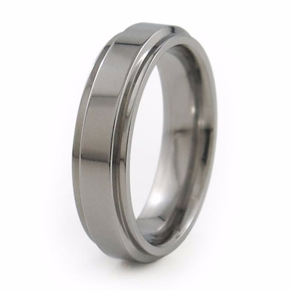 Ladies Aria titanium ring features squared edge cuts on each side to further accent its crisp, classic look.