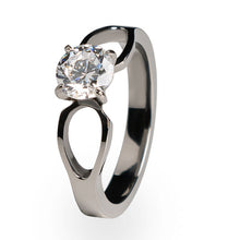 Slender and attractive, this solitaire engagement ring is made of pure, hypoallergenic Titanium. Choose from a wide selection of diamonds and gemstones and make this beautiful ring your own.