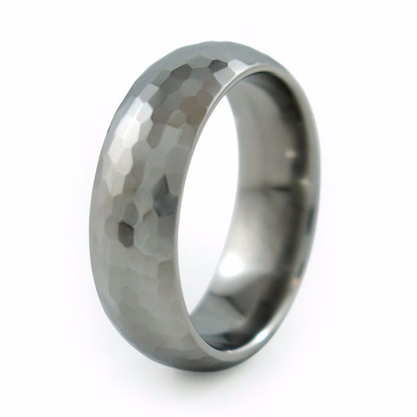 This gently domed Crater Titanium ring was further enhanced with an antiqued, hammered texture. The bumpy surface is rugged yet elegant and provides a smooth, comfortable feel.