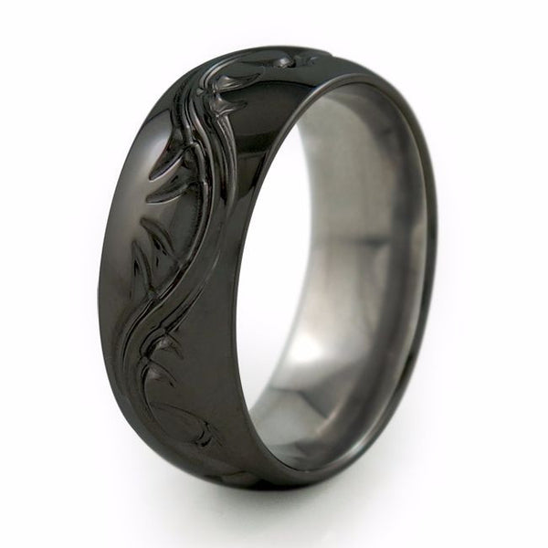 Black titanium ring with elegant serpentine design that is often seen in tattoos.